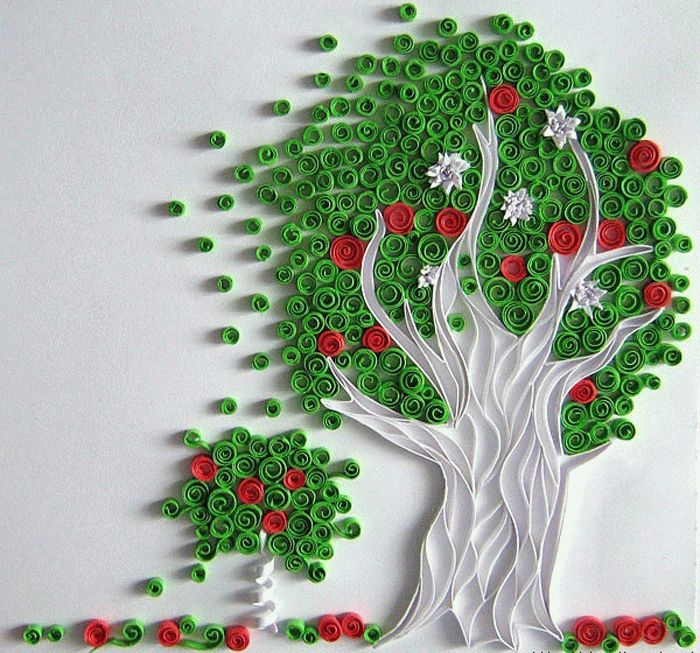 Такое объемное дерево на стене можно создать при помощи цветной бумаги или ткани