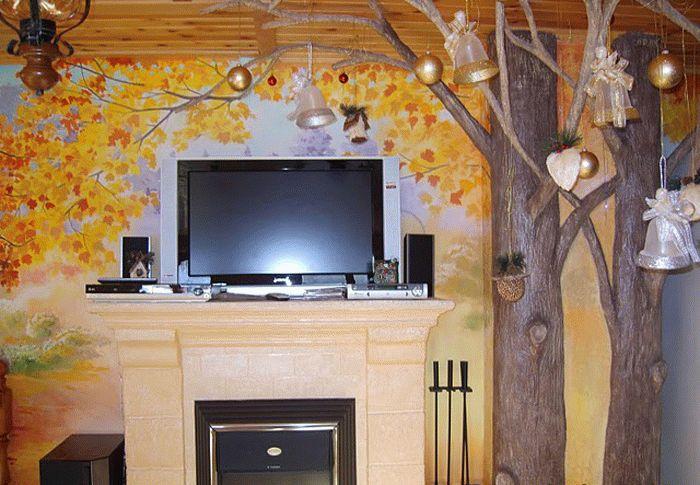 Эффект натуральности придадут сухие ветки природного дерева, которыми можно дополнить рисунок