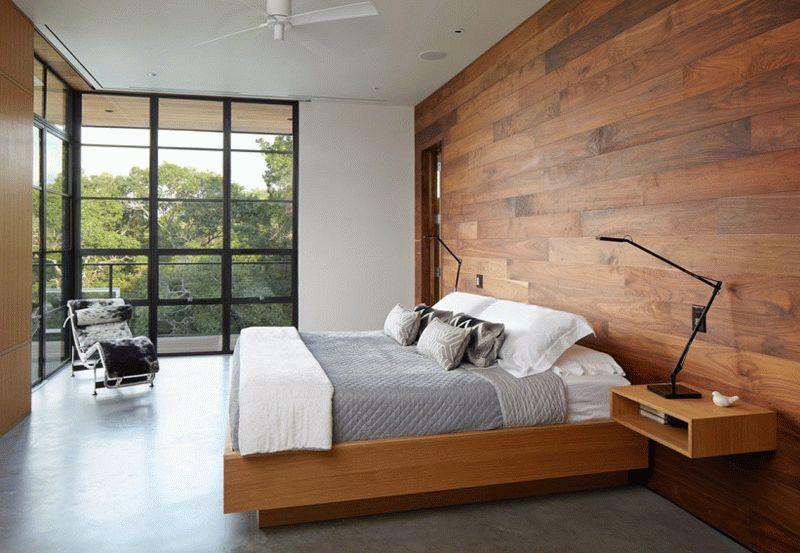 Наиболее часто ламинат в спальне используется для оформления стены у изголовья кровати